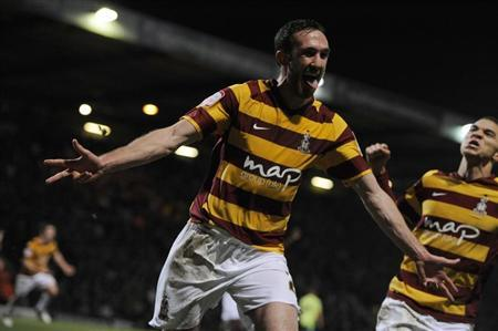 Bradford City's Rory McArdle celebrates after scoring against Aston Villa during their English League Cup semi-final soccer match in Bradford, northern England, January 8, 2013. REUTERS/Nigel Roddis