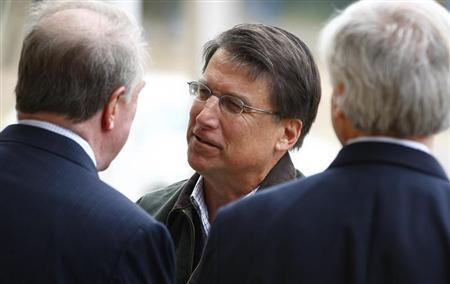 Pat McCrory meets supporters outside Myers Park Traditional Elementary school during the U.S. presidential election in Charlotte, North Carolina November 6, 2012. REUTERS/Chris Keane