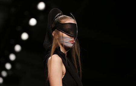 A model presents a creation from the Haizhen Wang Autumn/Winter 2013 collection during London Fashion Week, February 19, 2013. REUTERS/Suzanne Plunkett