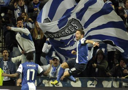 Porto's Joao Moutinho celebrates after scoring against Malaga during their Champions League soccer match at the Dragao stadium in Porto, February 19, 2013. REUTERS/Jose Manuel Ribeiro