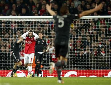 Arsenal's Mikel Arteta reacts after Bayern Munich scored a third goal during their Champions League soccer match at the Emirates Stadium in London February 19, 2013. REUTERS/Eddie Keogh