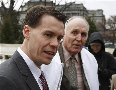 Mark Walters (L), attorney for Indiana soybean farmer Vernon Bowman (R), speaks to the media outside the Supreme Court in Washington, February 19, 2013, following arguments in Bowman's case against global seed giant, Monsanto. REUTERS/Jason Reed
