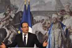 France's President Francois Hollande leaves after delivering a speech to celebrate Chinese New Year at the Elysee Palace in Paris, February 18, 2013. REUTERS/Philippe Wojazer