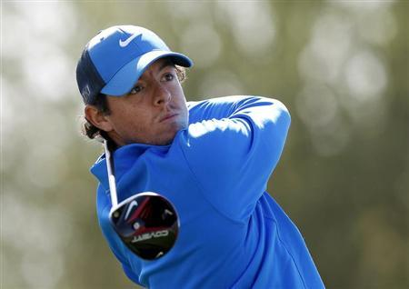 Rory McIlroy of Northern Ireland watches his tee shot on the 11th hole during a practice round for the WGC-Accenture Match Play Championship golf tournament in Marana, Arizona February 19, 2013. REUTERS/Matt Sullivan