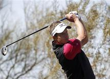 Luke Donald of England watches his tee shot on the ninth hole during a practice round for the WGC-Accenture Match Play Championship golf tournament in Marana, Arizona February 19, 2013. REUTERS/Matt Sullivan