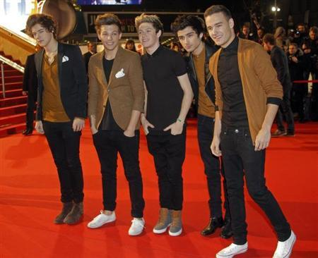 Members of British group One Direction arrive at the Cannes festival palace to attend the NRJ Music Awards in Cannes January 26, 2013. REUTERS/Jean-Paul Pelissier