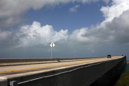 Cars drive north along the Overseas Highway near Craig Key, Florida September 8, 2008. REUTERS/Eric Thayer