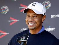 Tiger Woods of the U.S. laughs during a news conference before a practice round for the WGC-Accenture Match Play Championship golf tournament in Marana, Arizona February 19, 2013. REUTERS/Matt Sullivan