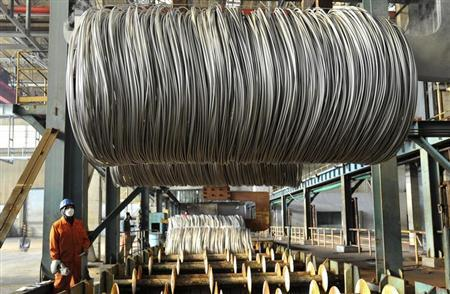 An employee works on a steel production line at an export factory in Dalian, Liaoning province, February 8, 2013. REUTERS/China Daily
