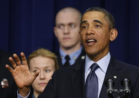 U.S. President Barack Obama talks against automatic budget cuts scheduled to take effect next week, while in the South Court Auditorium in the Eisenhower Executive Office Building in the White House complex in Washington February 19, 2013. REUTERS/Larry Downing