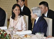 Peruvian President Ollanta Humala's wife Nadine Heredia (L) speaks with Japanese Emperor Akihito before a luncheon at the Imperial Palace in Tokyo May 9, 2012, in this handout photo released by the Imperial Household Agency of Japan. REUTERS/Imperial Household Agency of Japan/Handout