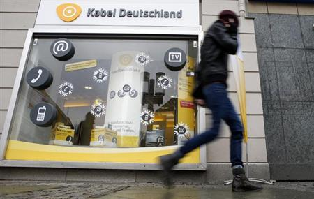 A pedestrian walks past a shop of cable television provider Kabel Deutschland in Berlin February 19, 2013. Vodafone is considering a bid for Germany's Kabel Deutschland to expand the UK-based mobile company's services in Europe's biggest economy, according to a person familiar with the matter. REUTERS/Fabrizio Bensch (GERMANY - Tags: BUSINESS TELECOMS)