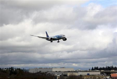 A Boeing 787 descends in Everett, Washington travelling with crew only from Fort Worth, Texas February 7, 2013. REUTERS/Kevin P. Casey