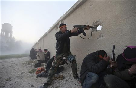 A Free Syrian Army fighter fires a rifle during an attack on a Syrian Army base in the Arabeen neighbourhood of Damascus in this February 3, 2013 file photo. REUTERS/Goran Tomasevic/Files