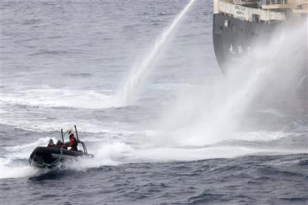 Japanese research vessel Nisshin Maru fires water cannons at the Sea Shepherd Delta boat in Mackenzie Bay, Antarctica in this handout picture taken on February 19, 2013 by Sea Shepherd Australia. REUTERS/Eliza Muirhead - Sea Shepherd Australia/Handout