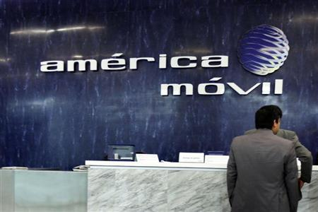 The logo of America Movil is seen on the wall of the reception area in the company's corporate offices in Mexico City February 13, 2013. REUTERS/Edgard Garrido