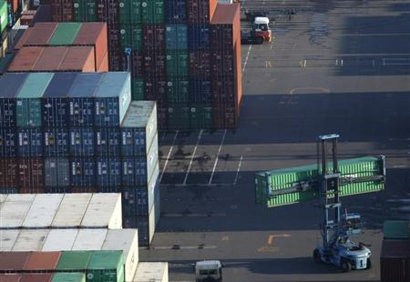 Containers are stacked up at a port in Tokyo January 24, 2013. REUTERS/Yuya Shino