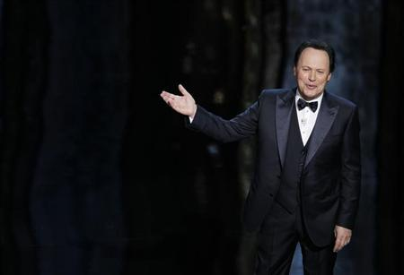 Oscar host Billy Crystal talks on stage at the 84th Academy Awards in Hollywood, California, February 26, 2012. REUTERS/Gary Hershorn