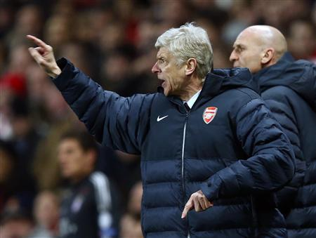 Arsenal manager Arsene Wenger reacts during their Champions League soccer match against Bayern Munich at the Emirates Stadium in London February 19, 2013. REUTERS/Eddie Keogh