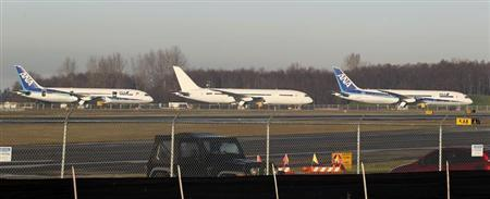 787 Dreamliner jets painted in All Nippon Airways (ANA) of Japan livery (L and R), sit idle with another unmarked 787 on the tarmac parking at Paine Field in Everett, Washington, January 17, 2013. REUTERS/Anthony Bolante