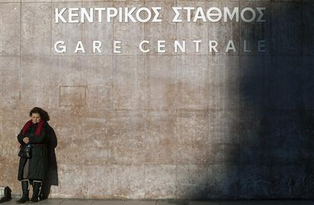A woman stands by Athens main train station during a 24-hour strike February 20, 2013. REUTERS/Giorgos Moutafis