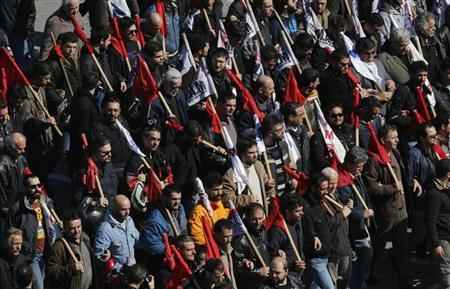 Anti-austerity protesters march through Athens' central Syntagma square during a 24-hour strike February 20, 2013. REUTERS/Yannis Behrakis