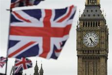 Flags are seen above a souvenir kiosk near Big Ben clock at the Houses of Parliament in central London June 26, 2012. REUTERS/Paul Hackett (BRITAIN - Tags: TRAVEL ROYALS POLITICS ENTERTAINMENT CITYSPACE) - RTR346KI