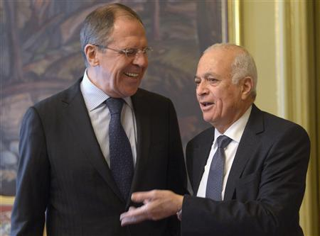 Russian Foreign Minister Sergei Lavrov (L) walks with the Secretary-General of the Arab League Nabil Elaraby prior to a Russia-Arab cooperation forum in Moscow February 20, 2013. REUTERS/Pool (RUSSIA - Tags: POLITICS) - RTR3E0OQ