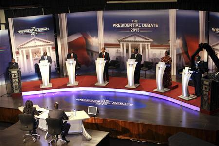 The eight Kenyan presidential aspirants Mohammed Dida, James Ole Kiyiapi, Uhuru Kenyatta, Peter Kenneth, Musalia Mudavadi, Martha Karua, Kenyan Prime Minister Raila Odinga and Paul Muite (L-R) face off in the first ever presidential debate at Brookhouse School in Kenya's capital Nairobi February 11, 2013. REUTERS/Stringer