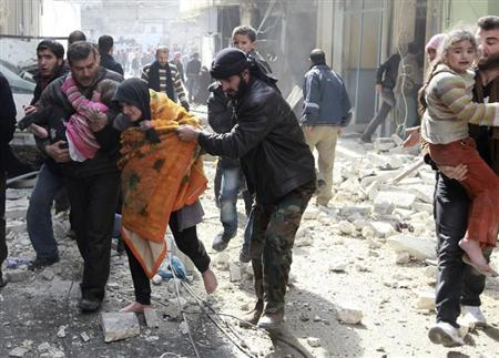 A Free Syrian Army fighter helps a family after a jet missile hit the al-Myassar neighbourhood of Aleppo February 20, 2013. REUTERS/Muzaffar Salman