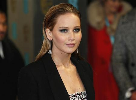 Actress Jennifer Lawrence poses as she arrives for the British Academy of Film and Arts (BAFTA) awards ceremony at the Royal Opera House in London February 10, 2013. REUTERS/Suzanne Plunkett