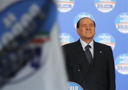 Former Italian Prime Minister Silvio Berlusconi attends a political rally in Turin February 17, 2013. REUTERS/Giorgio Perottino (ITALY - Tags: POLITICS ELECTIONS) - RTR3DWZ2