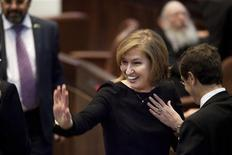 Hatnua party leader and former foreign minister Tzipi Livni gestures after the swearing-in ceremony of the 19th Knesset, the new Israeli parliament, in Jerusalem February 5, 2013. REUTERS/Uriel Sinai/Pool