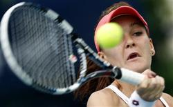 Agnieszka Radwanska of Poland hits a return to Yulia Putintseva of Kazakhstan during their women's singles match at the WTA Dubai Tennis Championships, February 20, 2013. REUTERS/Ahmed Jadallah