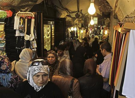 People shop at the main market, or souk, in the Syrian city of Aleppo June 23, 2010. REUTERS/Khaled al-Hariri