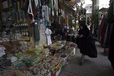 An Iranian pilgrim shops at a market in Kerbala , 110 km (70 miles) south of Baghdad January 23, 2013. REUTERS/Mushtaq Muhammed