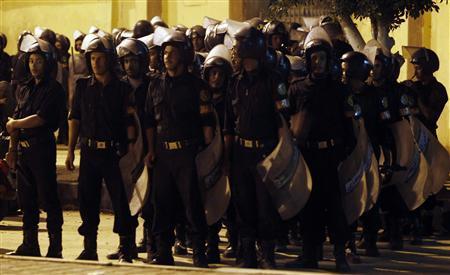 Egyptian riot police stand guard as a policeman unloads ballot boxes from a truck at Mahalla El Kubra, north of Cairo, November 28, 2010. REUTERS/Amr Abdallah Dalsh