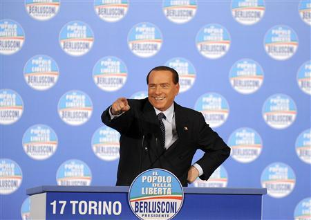 Former Italian Prime Minister Silvio Berlusconi gestures during a political rally in Turin February 17, 2013. REUTERS/Giorgio Perottino