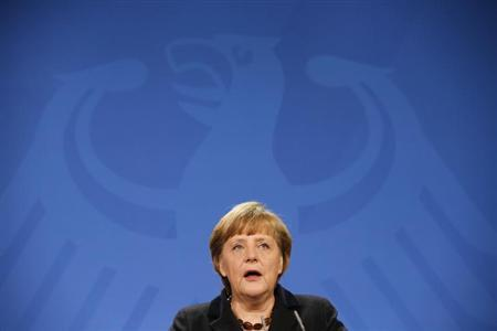 German Chancellor Angela Merkel makes a statement in the Chancellery in Berlin, February 11, 2013. REUTERS/Fabrizio Bensch (GERMANY - Tags: POLITICS RELIGION)