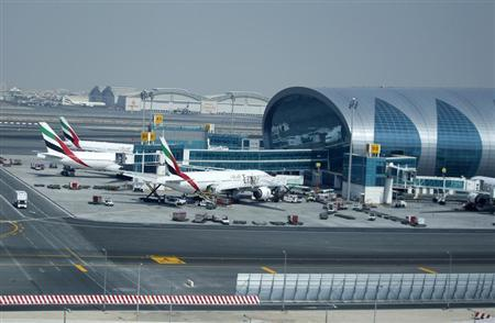 Emirates Airlines aircraft are seen near concourse A at the Emirates Terminal at Dubai International Airport, February 10, 2013. REUTERS/Jumana El Heloueh