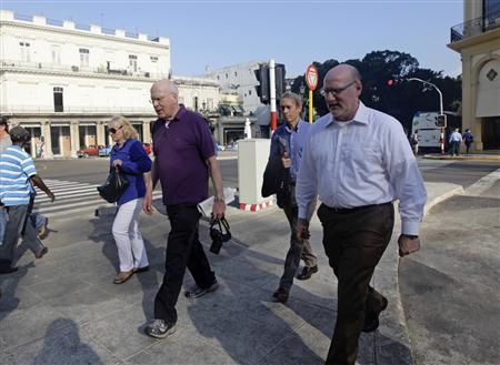 Democratic Senator Patrick Leahy (2nd L) of Vermont and his wife Marcelle Pomerleau, (L), walk with staff members on a street in Havana February 20, 2013. REUTERS/Desmond Boylan