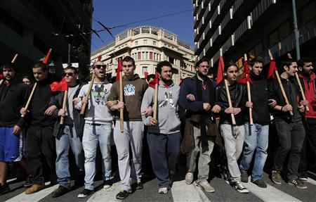 Protesters march during an anti-austerity rally in central Athens February 20, 2013. Tens of thousands of Greeks took to the streets of Athens on Wednesday during a nationwide strike against wage cuts and high taxes that kept ferries stuck in ports, schools shut and hospitals with only emergency staff. REUTERS/John Kolesidis