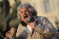Five-Star Movement leader and comedian Beppe Grillo gestures during a rally in Turin in this February 16, 2013 file photo. ITALY-ELECTION/ REUTERS/Giorgio Perottino/Files
