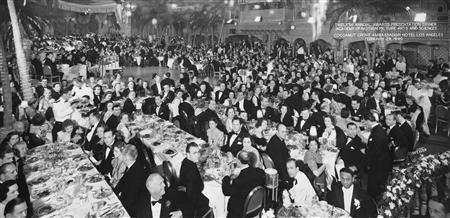 Oscar-winning actress Hattie McDaniel (center, bottom) sits at the very back of the room, away from her fellow ''Gone with the Wind'' stars, at the 1940 Academy Awards awards dinner in the Los Angeles's Ambassador Hotel in this handout photo. REUTERS/Courtesy of Margaret Herrick Library/AMPAS/Handout