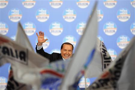 Former Italian Prime Minister Silvio Berlusconi waves to supporters during a political rally in Turin February 17, 2013. REUTERS/Giorgio Perottino