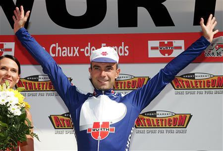 Spain's Angel Vicioso celebrates on the podium after winning the fourth stage of the Tour de Suisse cycling race from Niederbipp to La Chaux-de-Fonds, June 13, 2006. REUTERS/ARC/Dominic Favre