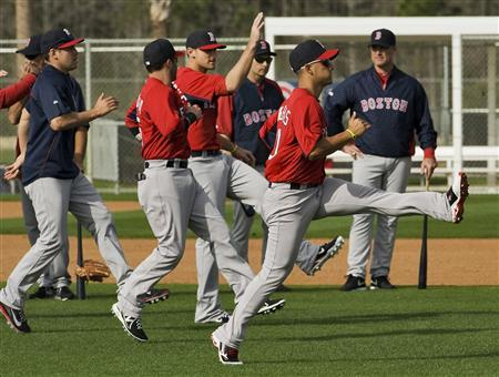 Boston Red Sox manager John Farrell (R) watches his players warm up during a workout at the team's MLB spring training complex in Fort Myers, Florida, February 16, 2013. REUTERS/Steve Nesius