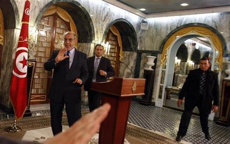 Tunisia's Prime Minister Hamadi Jebali (L) gestures as he leaves after announcing his resignation during a news conference in Tunis February 19, 2013. REUTERS/Zoubeir Souissi