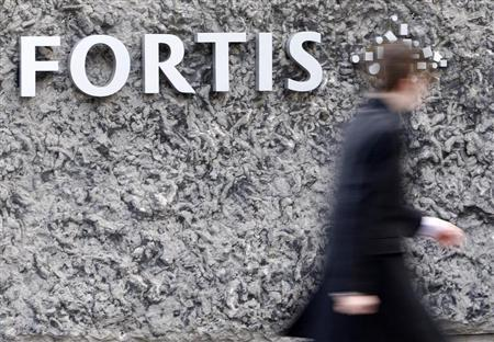 A man walks past the logo of the financial group Fortis NV at the entrance of the company's headquarters in Brussels March 6, 2009. REUTERS/Yves Herman