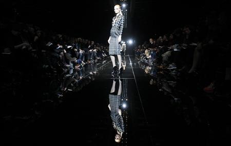 A model presents a creation from Gucci Autumn/Winter 2013 collection at Milan Fashion Week February 20, 2013. REUTERS/Alessandro Garofalo